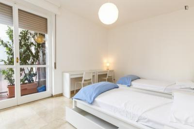 Bed in a welcoming twin bedroom near Politecnico University