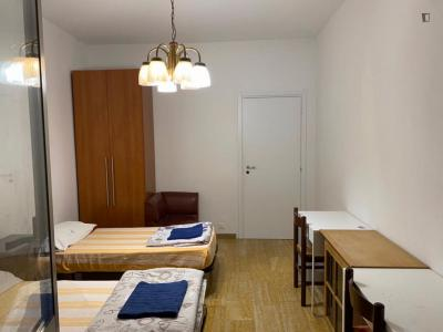 Bed in a twin bedroom close to NABA