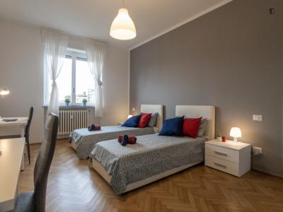 Bed in a twin bedroom connected with Cattolica University