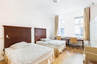 Bed in a twin bedroom, in residential Wedding
