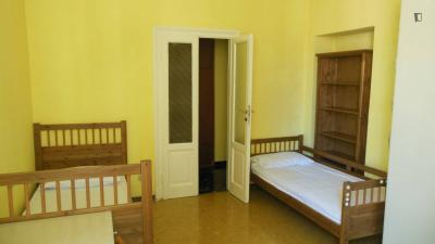 Bed in a twin bedroom, close to ISAD