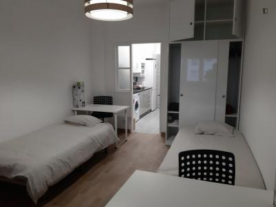 Bed in a twin bedroom, in a modern flat near the Monte-Abraão train station