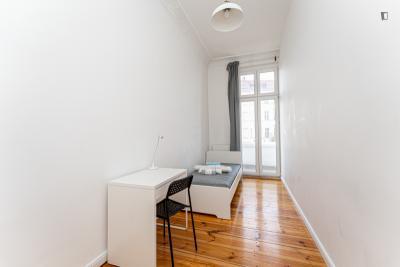 Shiny single bedroom with balcony in a 4-bedroom apartment near Berlin Ostkreuz Station