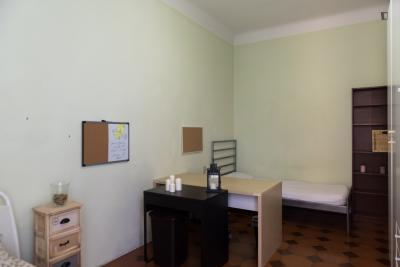 Bed in a twin bedroom in Città Studi area